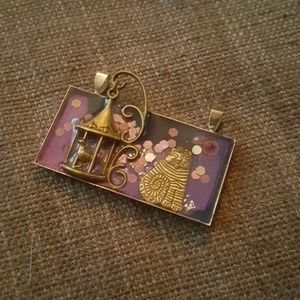 Purple and bronze cat birdcage resin pendant